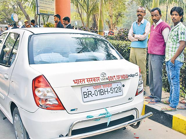 A car damaged during the scuffle between medicos and bank employees, on the IGIMS campus, in Patna on Tuesday