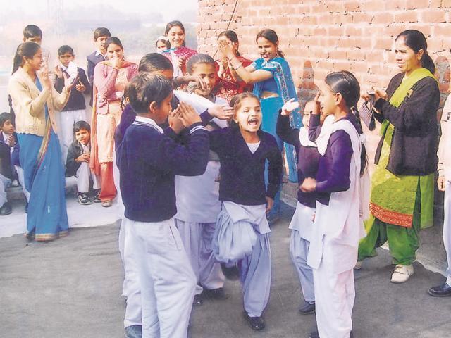 Students singing the National Anthem during Republic Day celebrations at the Gobindpura madrasa in Chandigarh.