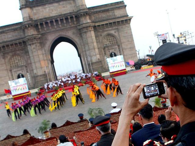 An Army officer takes photographs of a cultural program on Army Day celebration at Gateway of India in Mumbai. The city's name was changed in 1995.