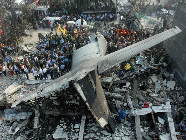 Rescuers search for victims where an air force cargo plane crashed in Medan, North Sumatra, Indonesia, in June last year. Another military plane crashed into a house near an air base in Malang, east Java, on Wednesday. Three people, including the pilot, were killed.