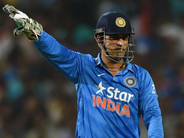 India's captain Mahendra Singh Dhoni makes field placement during the first T20 against Sri Lanka.