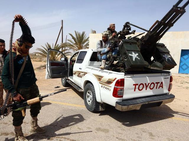 This file photo taken on March 16, 2015 shows forces  preparing to launch attacks as they continue to fight Islamic State (IS) group jihadists on the outskirts of Libya's western city of Sirte.