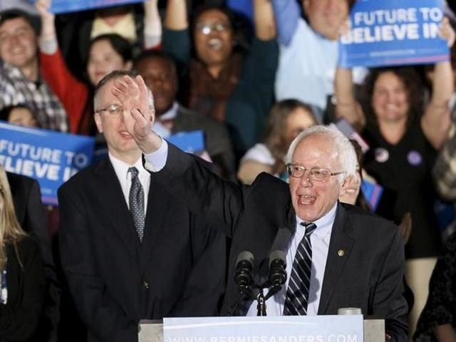 US Democratic presidential candidate Bernie Sanders smiles after winning at his 2016 New Hampshire presidential primary night rally in Concord, New Hampshire.