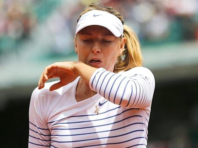 Maria Sharapova has withdrawn from the Qatar Open due to a persistent arm injury.