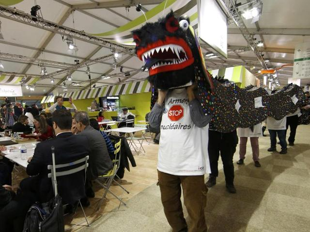 Anti-nuclear weapon activists demonstrate at the Generation Climate pavillon at the World Climate Change Conference 2015 (COP21) in Le Bourget, near Paris, France.