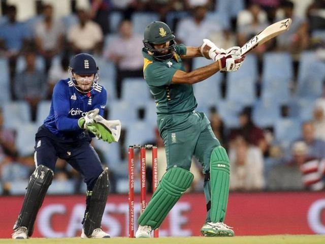 South African batsman Hashim Amla celebrates after scoring his century.
