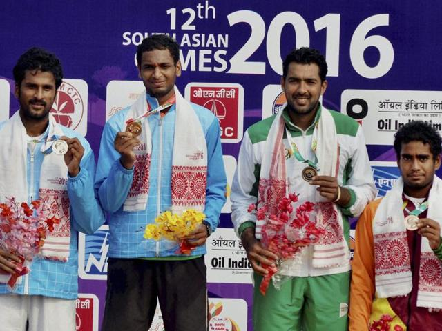 Gold medal winners Prarthana Thombare and Sharrmadaa Baluu during the South Asian Games .