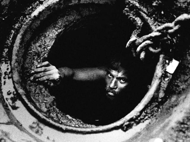 An image from In Search of Dignity and Justice series: The untold story of Mumbai's conservancy workers. About 40,000 conservancy workers are employed by the BMC. They collect garbage, clean gutters and work in the dumping grounds.