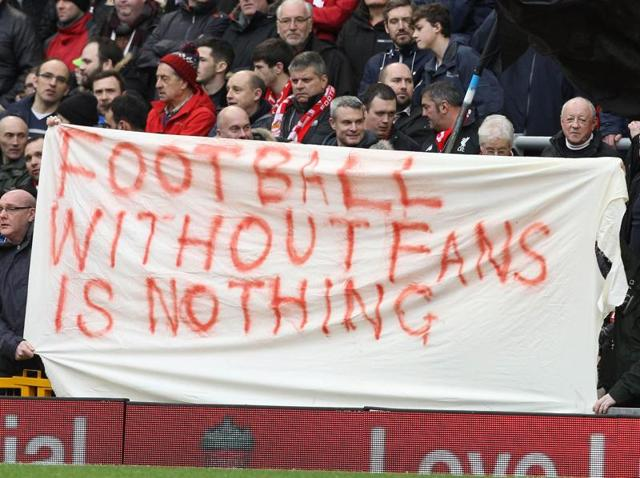A file photo of Liverpool fans holding a banner as they protest against the rise in ticket prices.
