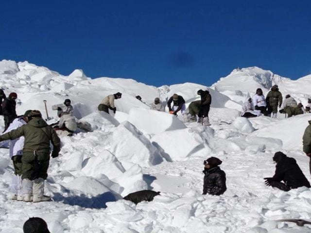 In this handout photograph released by the Indian Defence Ministry on February 8, 2016, Indian army personnel search for survivors after a deadly avalanche on the Siachen glacier.