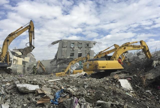 This file picture taken on February 6, 2016 shows rescue personnel working at the site of a collapsed building in the southern Taiwanese city of Tainan.
