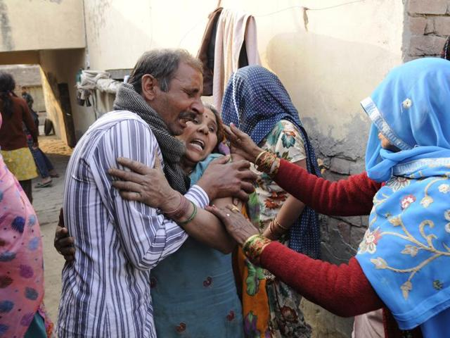 Family members mourn after the murder of a Dalit man over property dispute at Kambakshpur village.