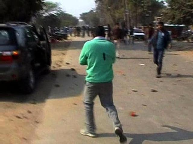 Devendra Singh clutches his heart after being shot at in Allahabad's Bahadurpur district.