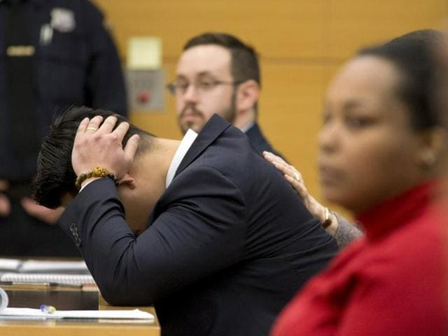 New York City Police officer (NYPD) Peter Liang reacts as the verdict is read during his trial in court room at the Brooklyn Supreme court.