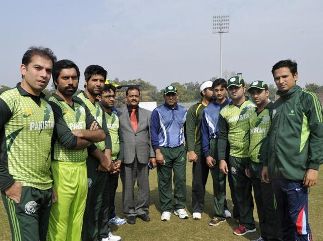 Pakistani lawyers before the start of a T20 match against their counterparts from the Punjab and Haryana Bar Council at the Sector-16 cricket stadium in Chandigarh on Thursday.