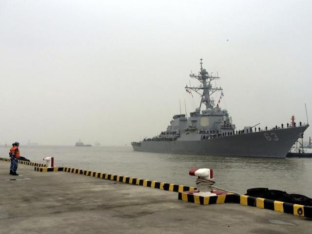 A ship (top) of the Chinese Coast Guard is seen near a ship of the Vietnam Marine Guard in the South China Sea. China has reacted sharply to a report suggesting that the United States and India were planning joint patrols of the disputed South China Seas region.