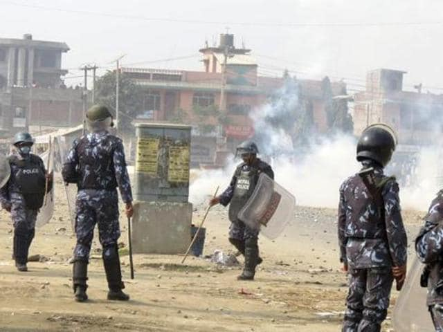 Nepalese policemen use tear gas to disperse ethnic Madhesi protesters in Gaur, a town about 160 km south of Kathmandue. (AP Photo/Gautham Shreshta)