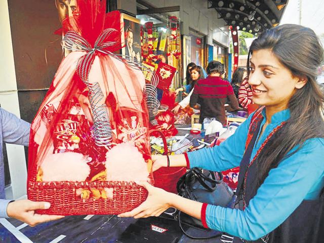 People take part in a Valentine's Day celebration in Lahore.