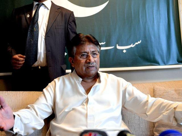 Former Pakistani President Pervez Musharraf talks to a journalist at his office in Dubai.