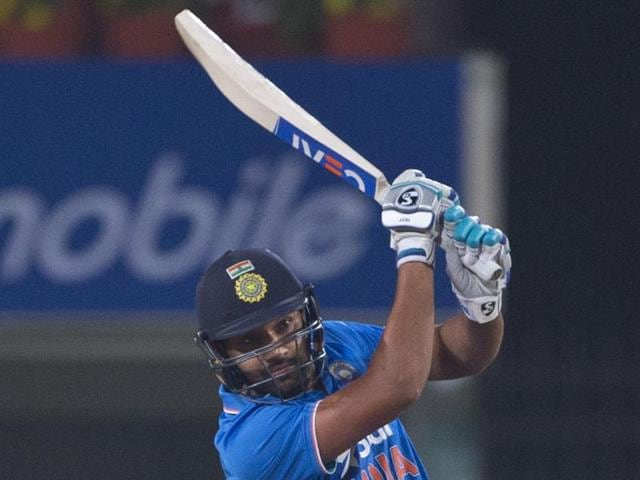 Indian batsman Rohit Sharma hits a four against Sri Lanka during the second T20 match between the two countries, in Ranchi on February 12, 2016.