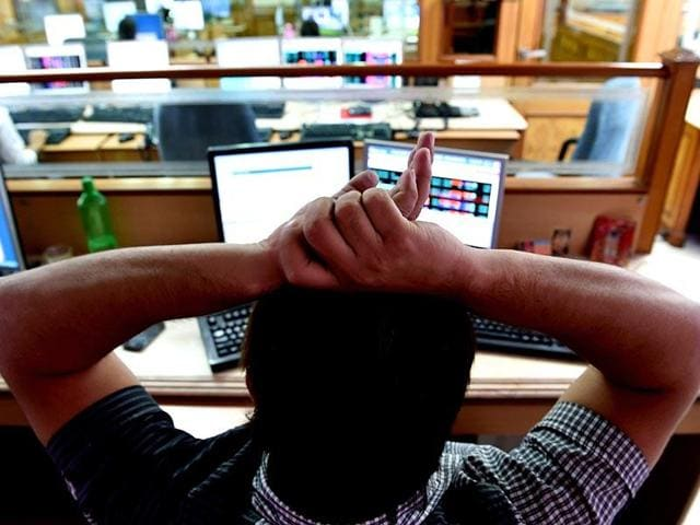 A stock dealer watches share prices on his screen at a brokerage house in Mumbai. (PTI File Photo)