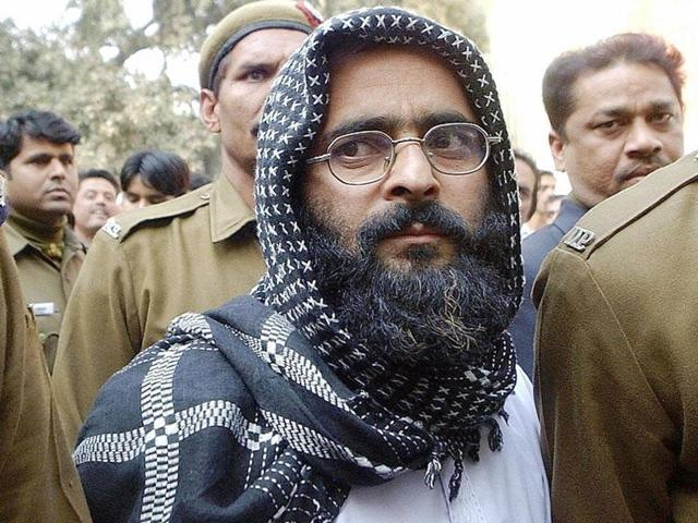 A file photo shows Parliament attack convict Afzal Guru being escorted to court. Police on Friday booked a DU professor for  under charges of sedition and criminal conspiracy for allegedly shouting anti-India slogans and hailing executed Parliament attack convict Afzal Guru as a martyr.