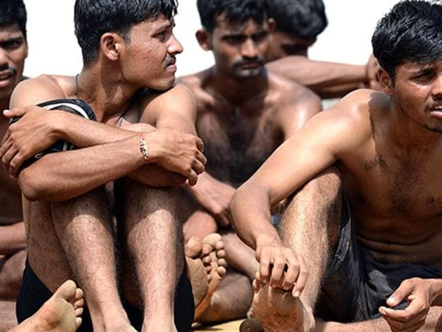 Youths wait for their turn at an army recruitment rally.