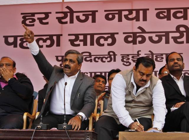 BJP leaders during the press conference on AAP government's one year in office on Saturday.