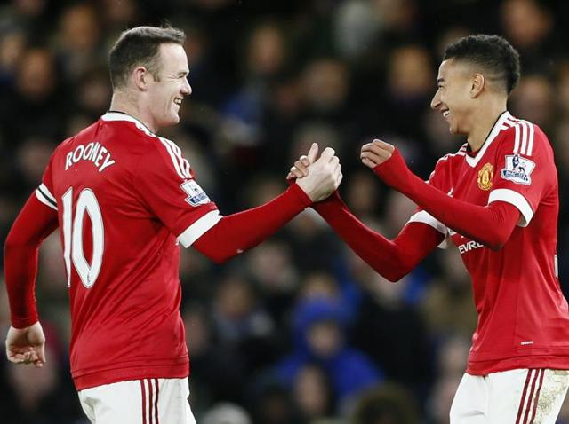 Manchester United's Jesse Lingard celebrates scoring their first goal with teammates.