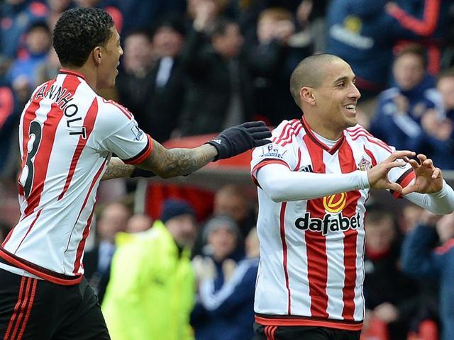 Sunderland's Wahbi Khazri celebrates scoring his team's first goal with  Patrick van Aanholt.