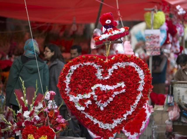 People buy flowers to celebrate Valentine's Day in Islamabad, Pakistan. Celebrating Valentine's Day is considered un-Islamic in Pakistan, but many still buy flowers and exchange gifts with others at this time of year.