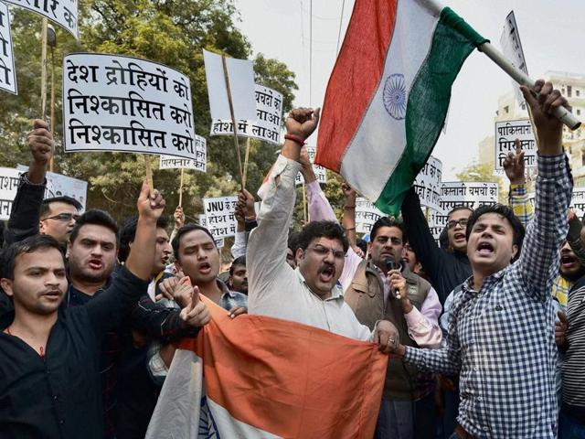 ABVP members protest against 'anti-national activities' at JNU, in New Delhi, on Friday.