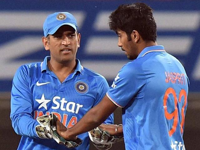 Mahendra Singh Dhoni, left, and Ravindra Jadeja share a light moment as they wait for a third umpire's decision against Sri Lanka during the second T20 in Ranchi on February 12, 2016.