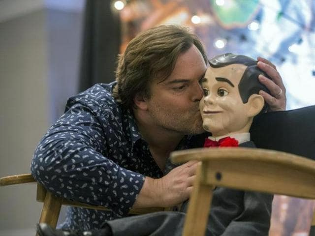 Jack Black kisses Slappy the Dummy during a photo call for Goosebumps in West Hollywood, California October 2, 2015. (Reuters)