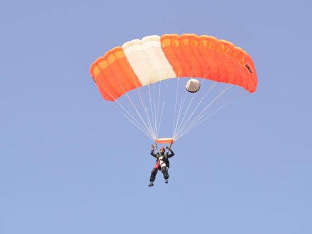 Rudra Bhanu Solanki landing after jumping from 7000 feet during Bhopal Adventure Fest on Sunday.