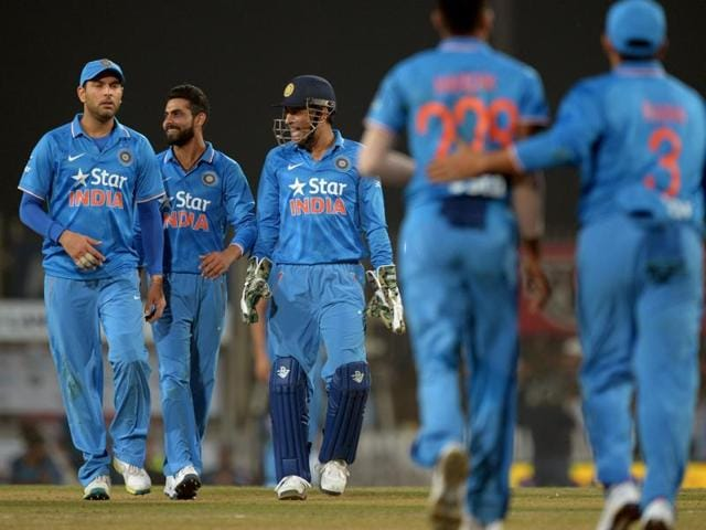 India's T20 cricket captain Mahendra Singh Dhoni with teammates celebrate during the second T20.