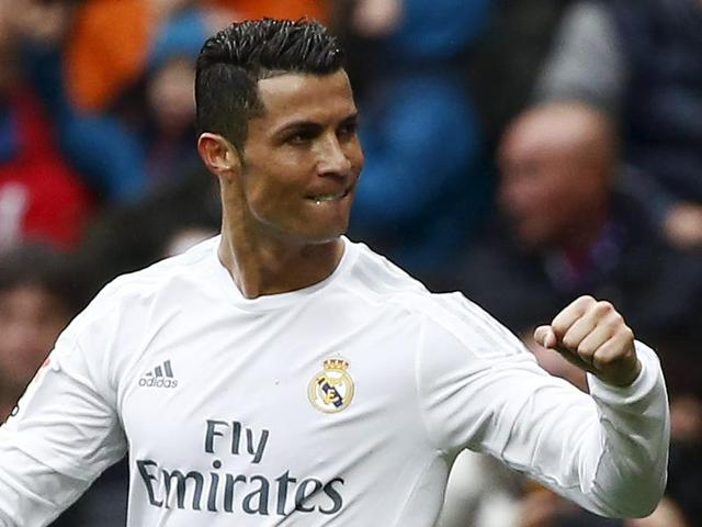 Real Madrid's Cristiano Ronaldo, center, celebrates after scoring a goal during the La Liga match against Athtletic Bilbao at the Santiago Bernabeu on February 13, 2016.