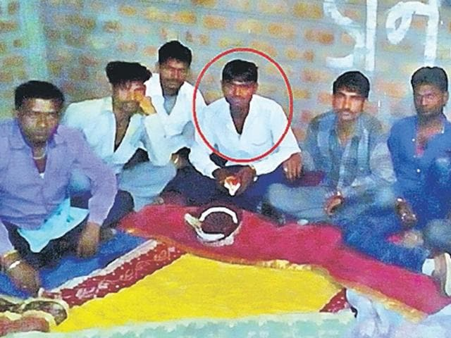 Groom Kanha (circled) waits with his friends, after a flying squad to check child marriages stopped the function in Indore.