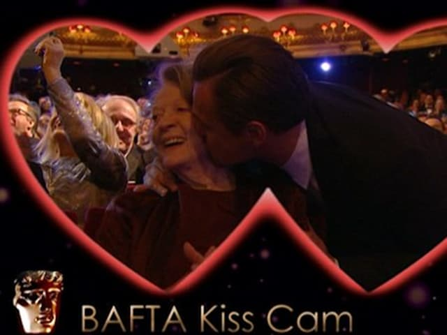 Leonardo DiCaprio gives Maggie Smith a big kiss after winning his first-ever best actor nod at BAFTA 2016 for The Revenant.