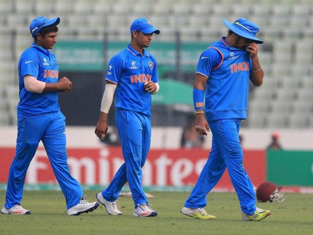 Left to right: India's Sarfaraz Khan, Ishan Kishan, Anmolpreet Singh and Aman Deep Khar leave the field after losing  the ICC Under-19 World Cup final to the West Indies in Dhaka on February 14, 2016.