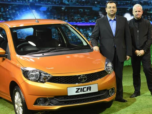 Tata's Timothy Liverton and Cyrus Mistry show off the new Tata Zica hatchback at the Auto Expo.  (Ravi Choudhary/HT Photo)