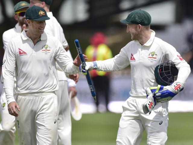 Australia's captain Steve Smith, left, and David Warner walk off after their team's innings and 52-run win over New Zealand on the fourth day of the first Test match at Basin Reserve in Wellington on February 15, 2016.