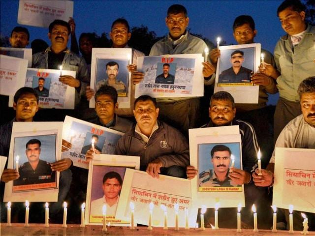 A group of social activists pay their homage to the soldiers who lost their lives after an avalanche hit their post in Siachen, Jammy and Kashmir.
