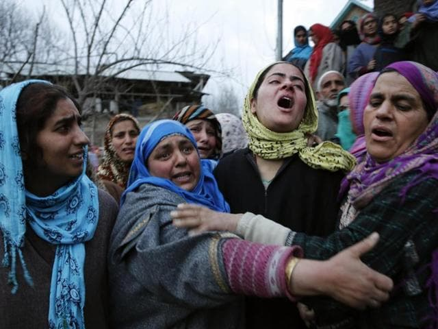 Relatives of Shaista Hamid mourn during her funeral in Lilhar south of Srinagar. A teenage boy and a young woman were killed on Sunday during a protest in Kashmir.