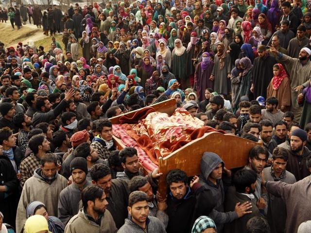 Kashmiri villages carry the body of Shaista Hamid during her funeral in Lelhara village in Pulwama district of J-K on Sunday, Feb. 14, 2016.  Hamid was killed in clashes with government forces.