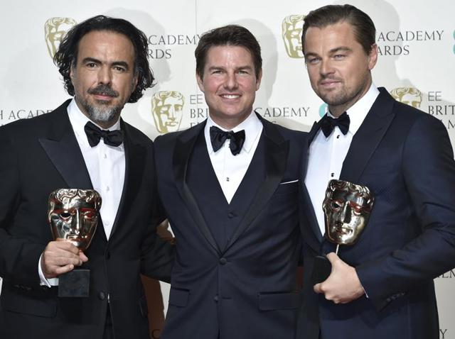 Best director Alejandro Inarritu (L) and best leading actor Leonardo DiCaprio hold their awards as they stand with presenter Tom Cruise at the British Academy of Film and Television Arts (BAFTA) Awards in London.