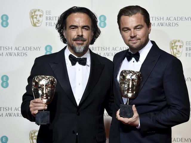Leonardo DiCaprio poses with presenter Tom Cruise at the British Academy of Film and Television Arts (BAFTA) Awards at the Royal Opera House in London, February 14.
