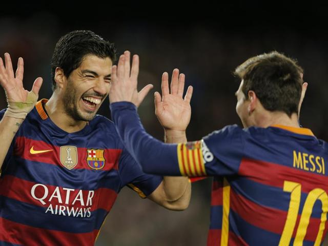 FC Barcelona's Luis Suarez, left, reacts after scoring a penalty prodded into his path by teammate Lionel Messi against Celta Vigo during the La Liga match at the Camp Nou stadium in Barcelona on February 14, 2016.