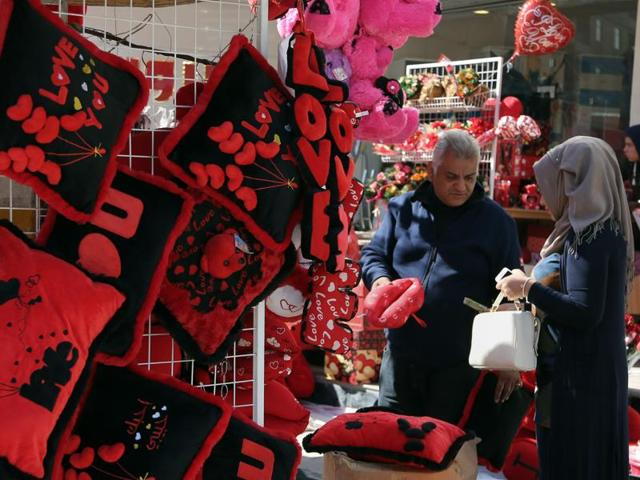 Baghdad is seen plastered with Valentine hearts and roses, and Iraqis are enjoying a rare lull in violence but wondering how long it will last.