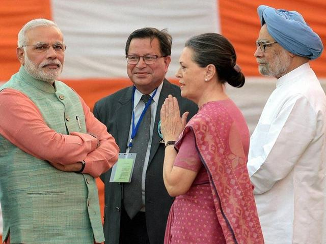 Prime Minister Narendra Modi, former PM Manmohan Singh and Congress President Soina Gandhi during Dussehra celebrations at Subhash Maidan in New Delhi.